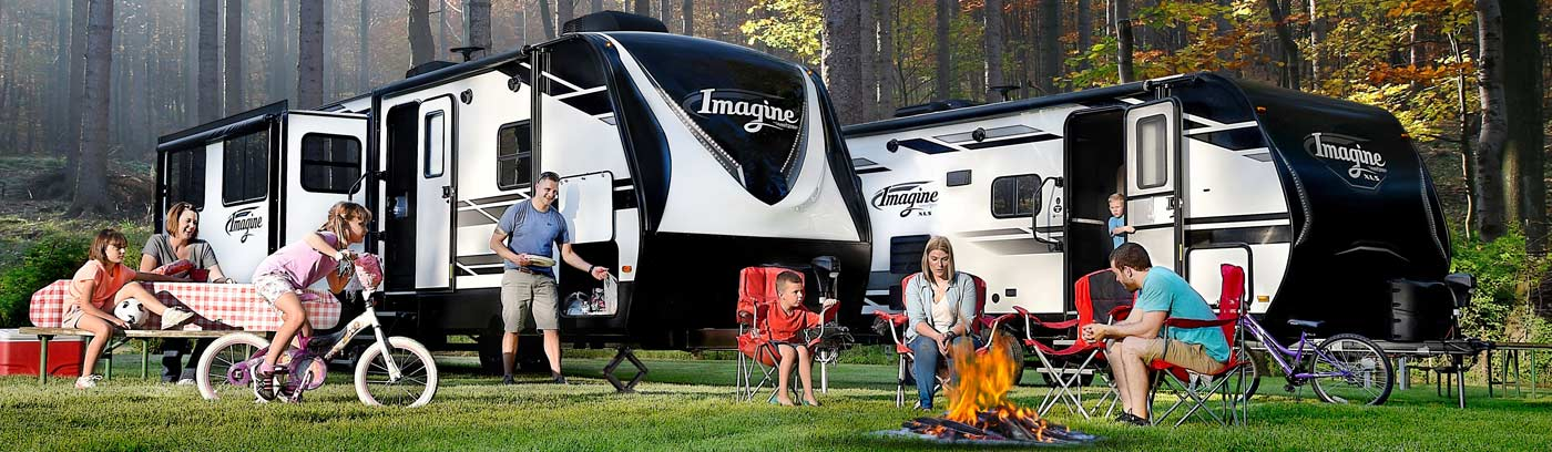 Family enjoying an outing in their Grand Design Imagine travel trailer.