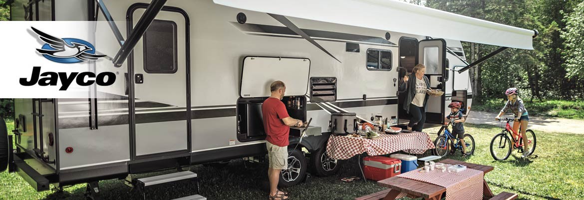 Photo of family at campground with their Jayco travel trailer.