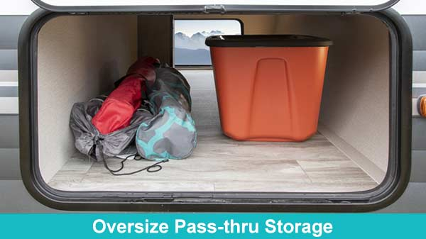 Photo of large unobstructed pass-thru storage compartment.